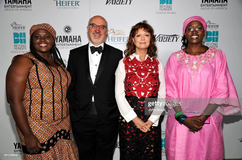 Heifer International's Petronella Halwiindi , CEO of Heifer International Pierre Ferrari, honoree <a gi-track='captionPersonalityLinkClicked' href=/galleries/search?phrase=Susan+Sarandon&family=editorial&specificpeople=202474 ng-click='$event.stopPropagation()'>Susan Sarandon</a>, and Heifer International's Elizabeth Bintliff attend Heifer International's 2nd Annual 'Beyond Hunger: A Place at the Table' to Help End World Hunger and Poverty at Montage Hotel on September 19, 2013 in Los Angeles, California.