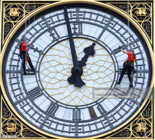 Height safety specialists Taskmasters abseil down St Stephens Tower which houses Big Ben in Westminster central London to aid heritage glazier Tony...