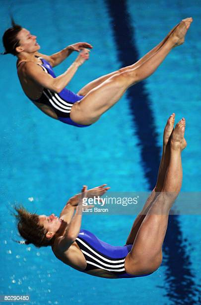 Heike Fischer and Ditte Kotzian of Germany on their way to win the silver medal during the Women's 3m Synchro Springboard Final round during day six...