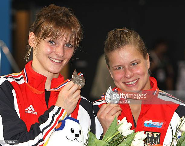 Heike Fischer and Ditte Kotzian of Germany pose with their silver medals after the Women's 3m Syncro Springboard during day six of the 29th LEN...