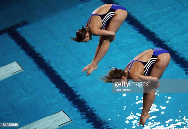 Heike Fischer and Ditte Kotzian of Germany winning silver medal are seen in action during the Women's 3m Synchro Springboard Final round during day...