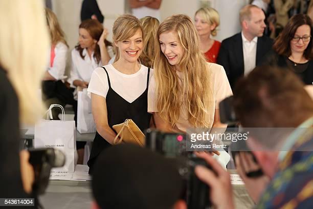 Heike Makatsch Pheline Roggan and Aino Laberenz attend the Malaikaraiss defilee during the Der Berliner Mode Salon Spring/Summer 2017 at...