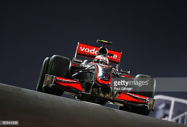 Heikki Kovalainen of Finland and McLaren Mercedes drives at night during practice for the Abu Dhabi Formula One Grand Prix at the Yas Marina Circuit...