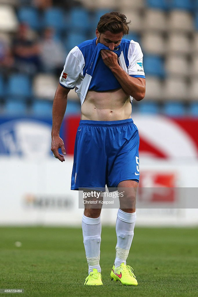 Heiko Butscher of Bochum hold his teeth after being knocked down during the pre-season friendly match between VfL Bochum and FC Schalke 04 at Rewirpower Stadium on August 5, 2014 in Bochum, Germany.