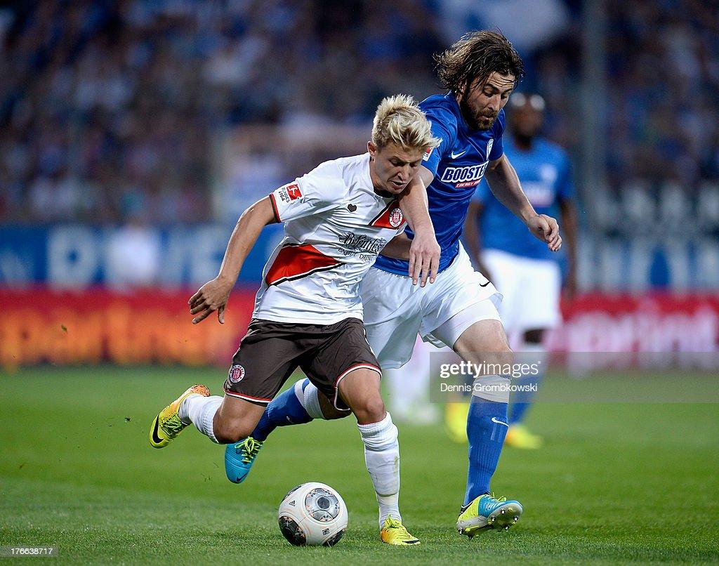 Heiko Butscher of VfL Bochum chases Marc Rzatkowski of St Pauli during the Second Bundesliga match between VfL Bochum and FC St Pauli at Rewirpower...