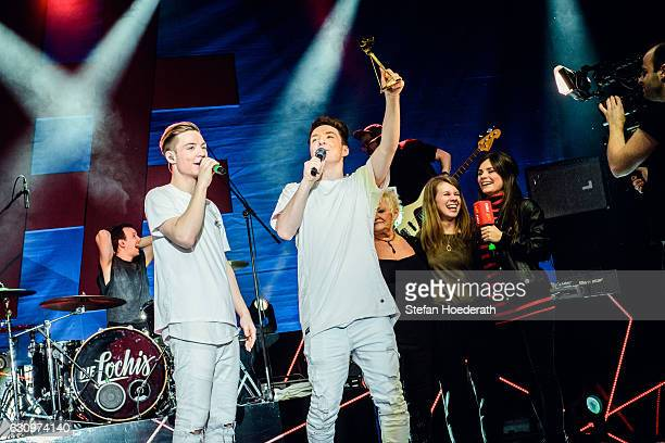 Heiko Lochman and his twin brother Roman of Die Lochis are awarded by Joyce Ilg the Goldene Kamera Digital Award on stage during a concert at...