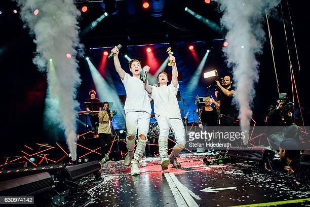 Heiko Lochman and his twin brother Roman of Die Lochis are awarded the Goldene Kamera Digital Award on stage during a concert at Columbiahalle on...