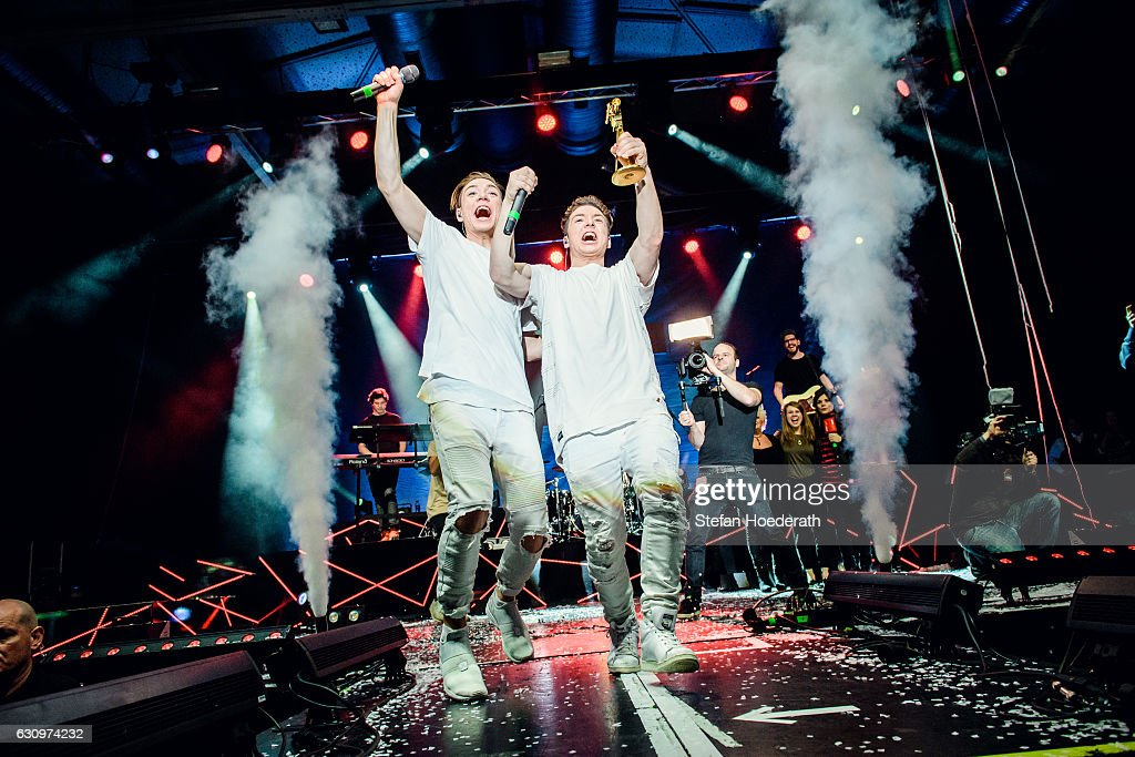 Heiko Lochman and his twin brother Roman of Die Lochis are awarded the Goldene Kamera Digital Award on stage during a concert at Columbiahalle on January 4, 2017 in Berlin, Germany.
