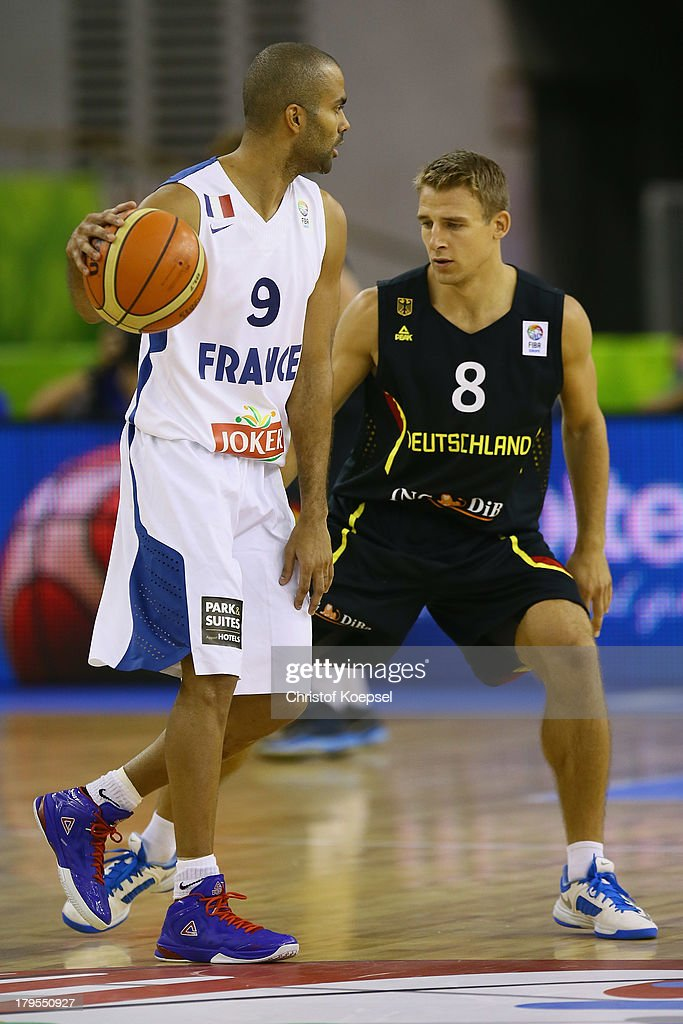 Heiko Schaffartzik of Gemany (R) defends against Tony Parker of France (L9 during the FIBA European Championships 2013 first round group A match between France and Germany at Tivoli Arena on September 4, 2013 in Ljubljana, Slovenia.