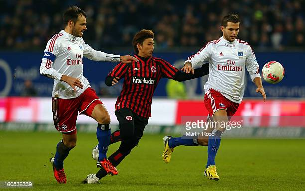 Heiko Westermann and Dennis Diekmeier of Hamburg and Takashi Inui of Frankfurt battle for the ball during the Bundesliga match between Hamburger SV...