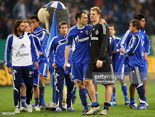 Heiko Westermann and goalkeeper Manuel Neuer of Schalke look dejected after losing 01 after extra time the DFB Cup semi final match between FC...