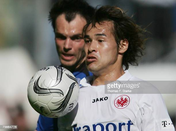 Heiko Westermann of Bielefeld and Naohiro Takahara of Frankfurt tackle for the ball during the Bundesliga match between Arminia Bielefeld and...
