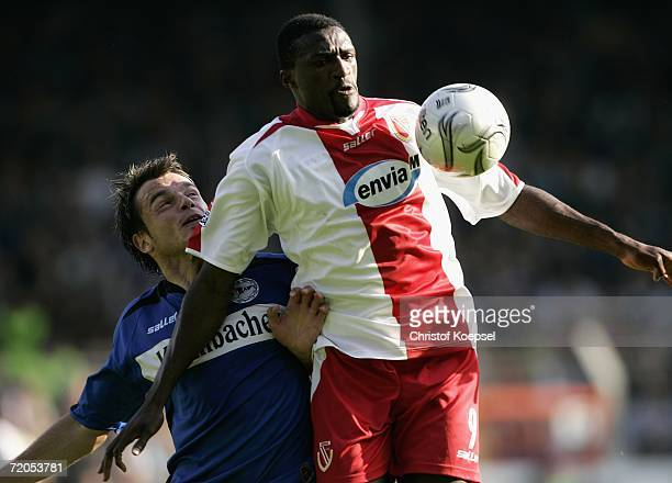 Heiko Westermann of Bielefeld challenges the ball against Francis Kioyo of Cottbus during the Bundesliga match between Arminia Bielefeld and Energie...