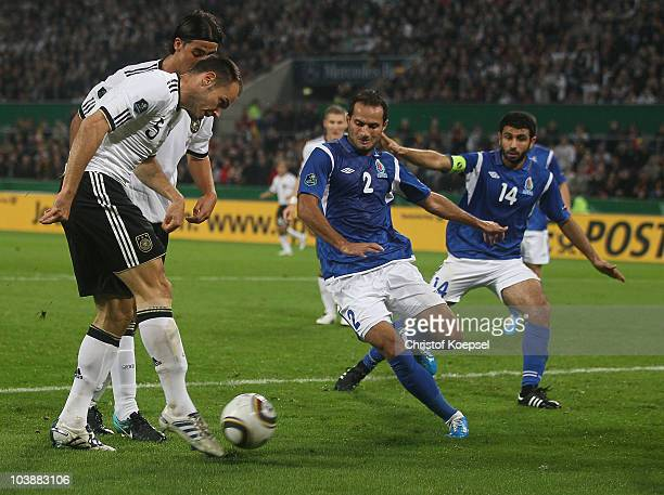 Heiko Westermann of Germany scores the first goal against Rail Malikov and Rashad Sadygov of Azerbaijan during the EURO 2012 Group A Qualifier match...