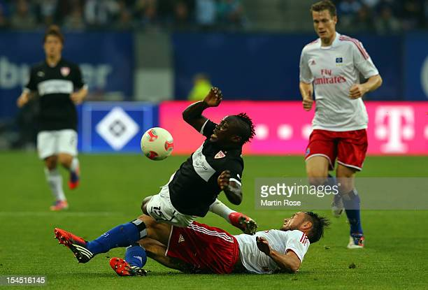 Heiko Westermann of Hamburg and Arthur Boka of Stuttgart battle for the ball during the Bundesliga match between Hamburger SV and VfB Stuttgart at...