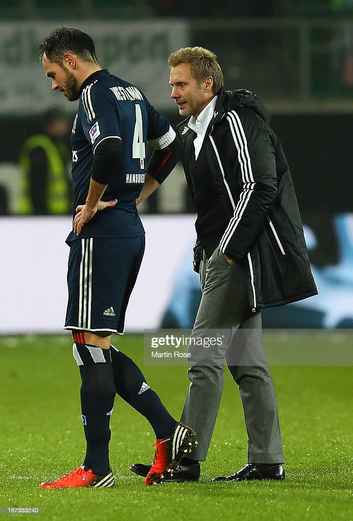 <a gi-track='captionPersonalityLinkClicked' href=/galleries/search?phrase=Heiko+Westermann&family=editorial&specificpeople=623650 ng-click='$event.stopPropagation()'>Heiko Westermann</a> (L) of Hamburg and head coach <a gi-track='captionPersonalityLinkClicked' href=/galleries/search?phrase=Thorsten+Fink&family=editorial&specificpeople=2381735 ng-click='$event.stopPropagation()'>Thorsten Fink</a> look dejected after the Bundesliga match between VfL Wolfsburg and Hamburger SV at Volkswagen Arena on December 2, 2012 in Wolfsburg, Germany.