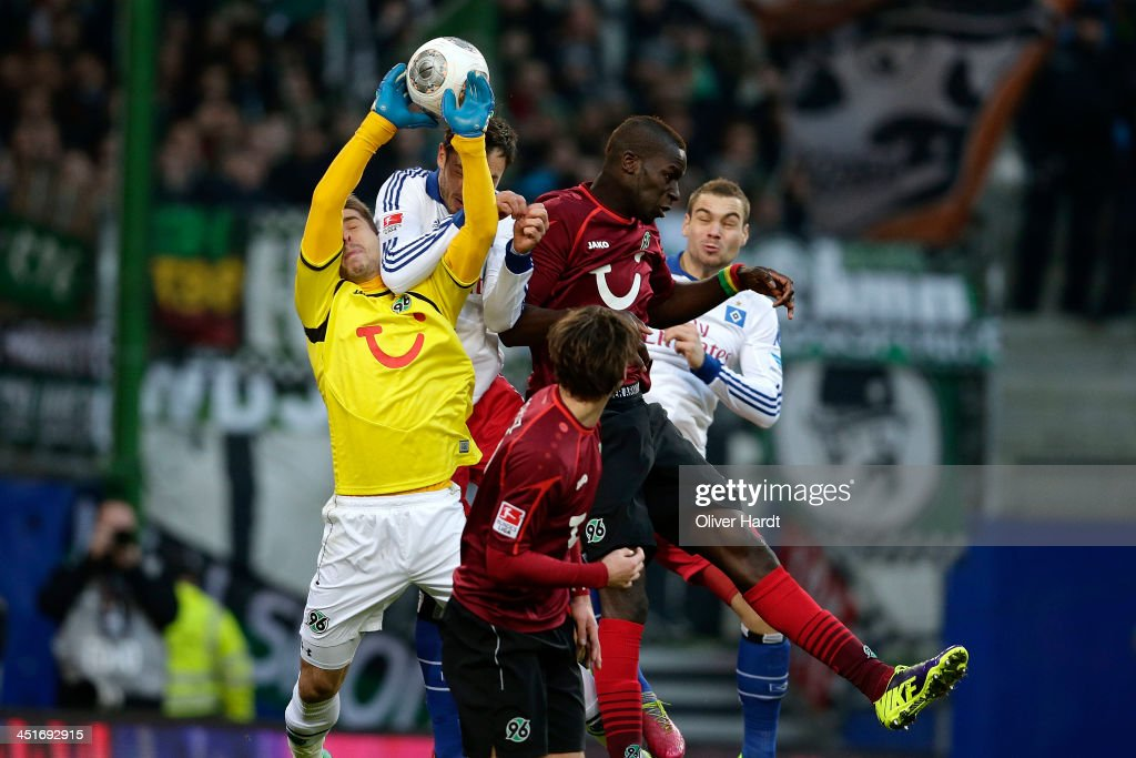 Heiko Westermann of Hamburg and Ron Robert Zieler of Hannover compete for the ball during the Bundesliga match between Hamburger SV and Hannover 96...
