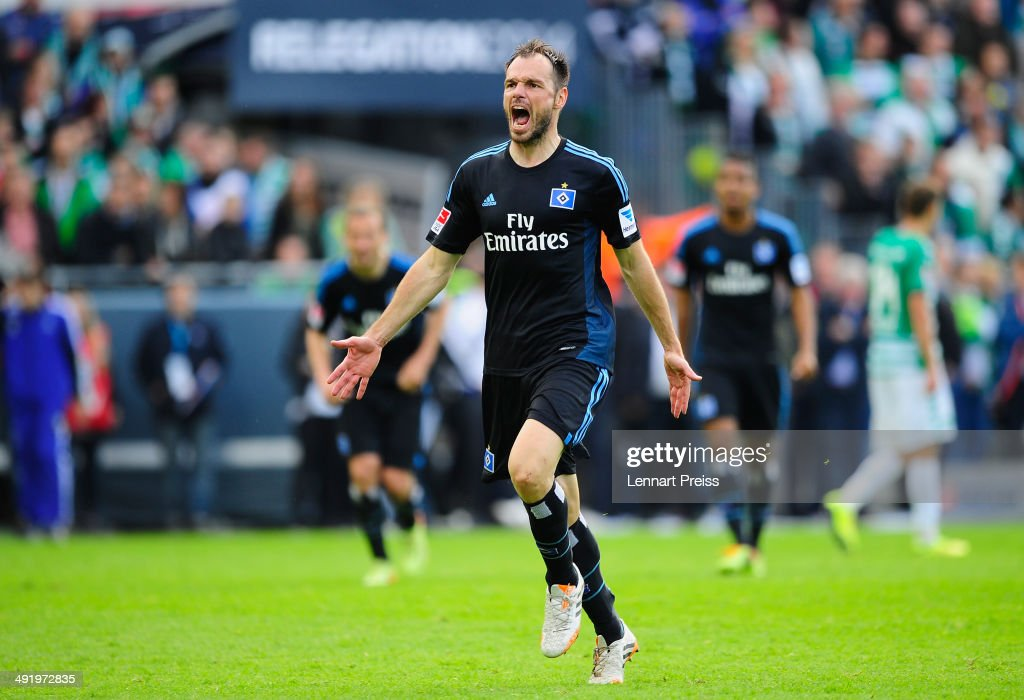 <a gi-track='captionPersonalityLinkClicked' href=/galleries/search?phrase=Heiko+Westermann&family=editorial&specificpeople=623650 ng-click='$event.stopPropagation()'>Heiko Westermann</a> of Hamburg celebrates after the Bundesliga Playoff Second Leg match between SpVgg Greuther Fuerth and Hamburger SV at Trolli-Arena on May 18, 2014 in Fuerth, Germany.