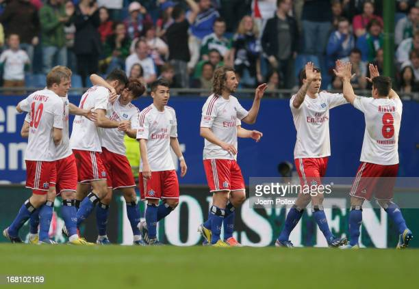 Heiko Westermann of Hamburg celebrates with his team mates after scoring his team's first goal during the Bundesliga match between Hamburger SV and...
