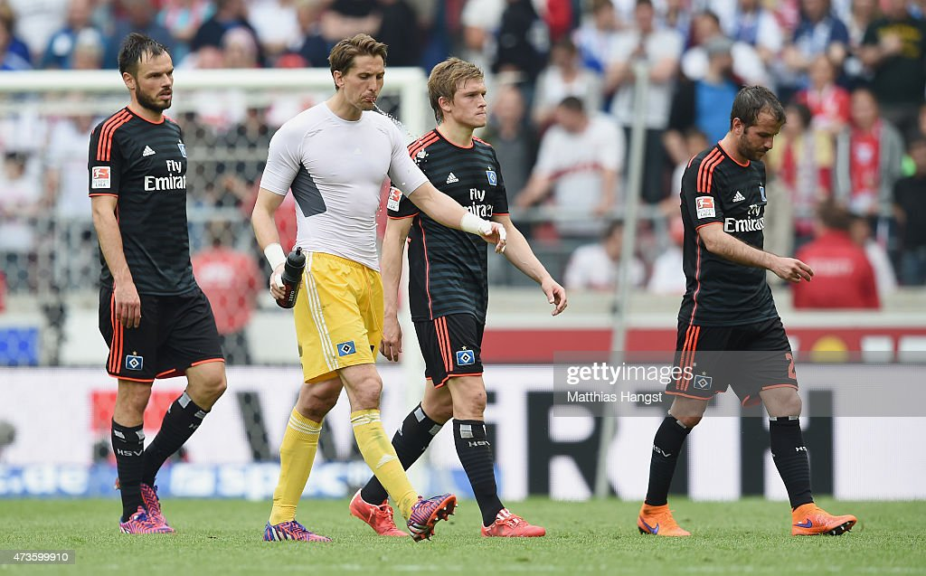 <a gi-track='captionPersonalityLinkClicked' href=/galleries/search?phrase=Heiko+Westermann&family=editorial&specificpeople=623650 ng-click='$event.stopPropagation()'>Heiko Westermann</a> of Hamburg, goalkeeper <a gi-track='captionPersonalityLinkClicked' href=/galleries/search?phrase=Rene+Adler&family=editorial&specificpeople=686184 ng-click='$event.stopPropagation()'>Rene Adler</a> of Hamburg, Artjomas Rudnevs of Hamburg and <a gi-track='captionPersonalityLinkClicked' href=/galleries/search?phrase=Rafael+van+der+Vaart&family=editorial&specificpeople=210815 ng-click='$event.stopPropagation()'>Rafael van der Vaart</a> of Hamburg show their disappointment after the Bundesliga match between VfB Stuttgart and Hamburger SV at Mercedes-Benz Arena on May 16, 2015 in Stuttgart, Germany.