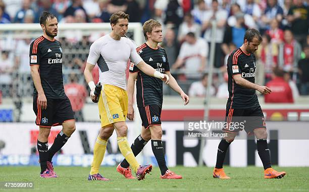 Heiko Westermann of Hamburg goalkeeper Rene Adler of Hamburg Artjomas Rudnevs of Hamburg and Rafael van der Vaart of Hamburg show their...