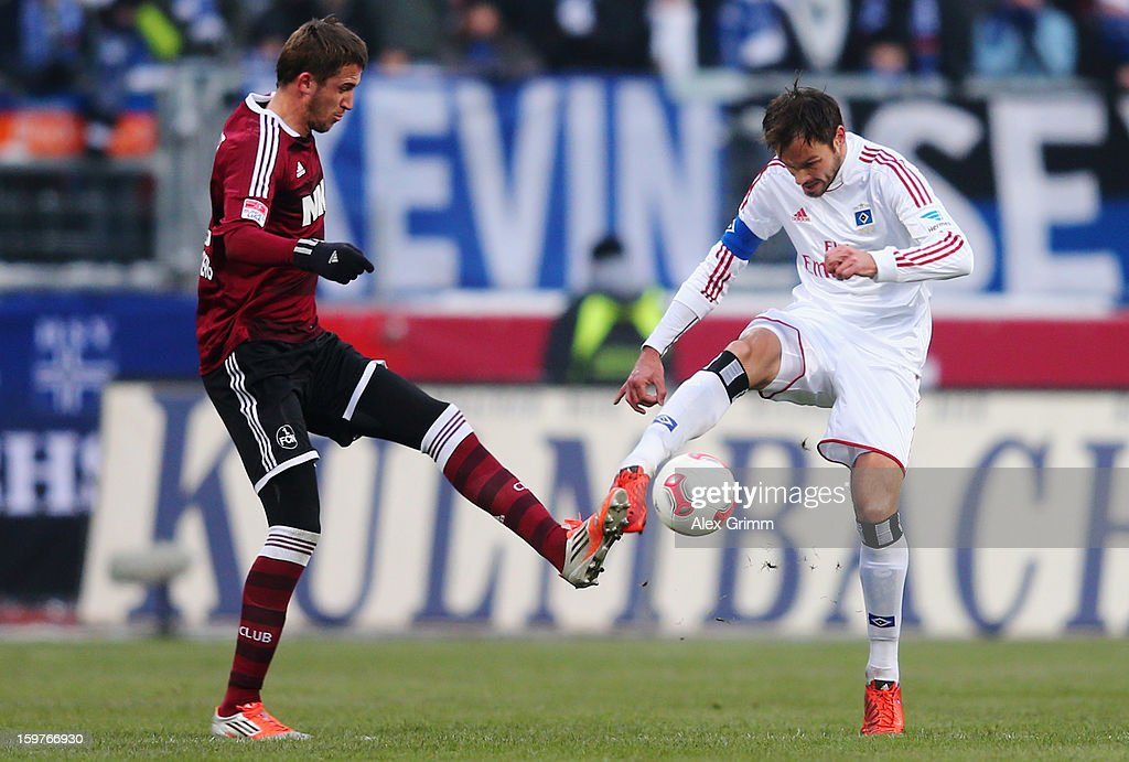 Heiko Westermann (R) of Hamburg is challenged by Tomas Pekarik of Nuernberg during the Bundesliga match between 1. FC Nuernberg and Hamburger SV at Easy Credit Stadium on January 20, 2013 in Nuremberg, Germany.