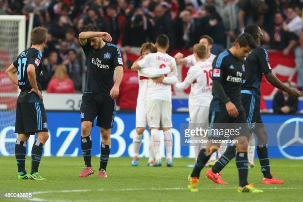 Heiko Westermann of Hamburg reacts with his team mates after the Bundesliga match between VfB Stuttgart and Hamburger SV at MercedesBenz Arena on...