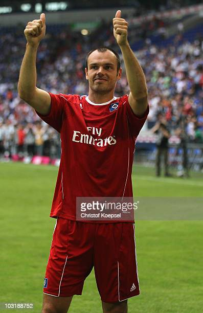 Heiko Westermann of Hamburg says farewell to the fans of Schalke after the LIGA total Cup 2010 third place playoff match between Hamburger SV and 1...