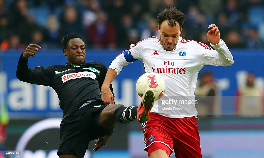 Heiko Westermann (r) of Hamburger SV is challenged by Abdul Rahman Baba (l) of Greuther Fuerth during the Bundesliga match between Hamburger SV and Greuther Fuert at Imtech Arena on March 2, 2013 in Hamburg, Germany.