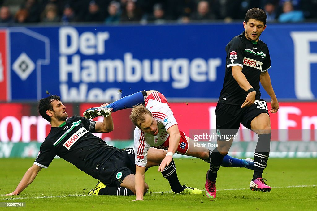 Heiko Westermann (l) of Hamburger SV is challenged by Nikola Djurdjic (r) of Greuther Fuerth (l) during the Bundesliga match between Hamburger SV and Greuther Fuert at Imtech Arena on March 2, 2013 in Hamburg, Germany.
