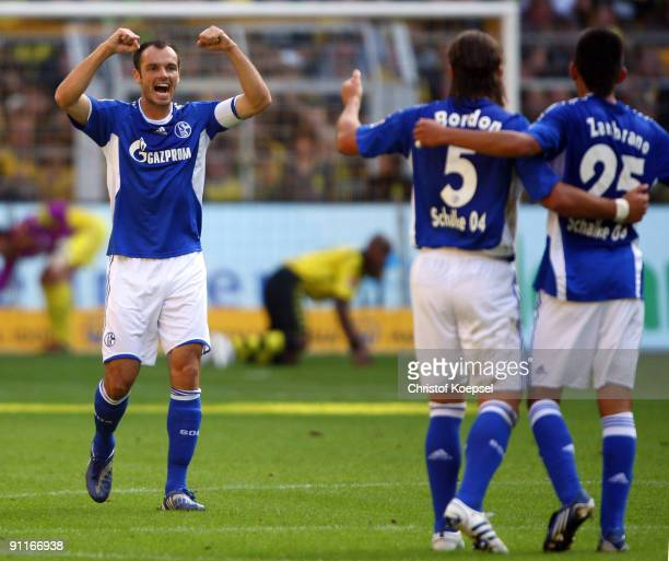 Heiko Westermann of Schalke celebrates scoring his team's first goal during the Bundesliga match between Borussia Dortmund and FC Schalke 04 at the...