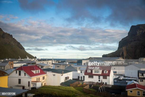 Heimaey small town and harbor in the Vestmann Islands in Iceland at morning.