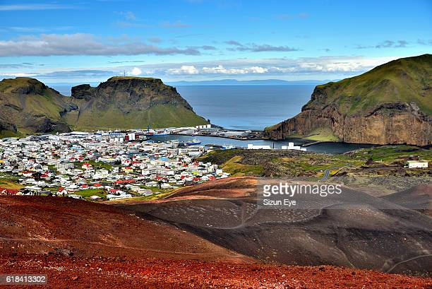 Heimaey town and harbour seen from Eldfell volcano in Iceland.