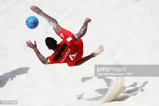 Heimanu Taiarui of Tahati attempts a scissor or bicycle kick shot on goal during the FIFA Beach Soccer World Cup Bahamas 2017 group D match between...
