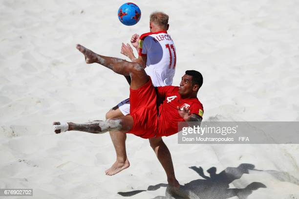 Heimanu Taiarui of Tahati attempts a scissor or bicycle kick shot on goal in front of Piotr Klepczarek of Poland during the FIFA Beach Soccer World...