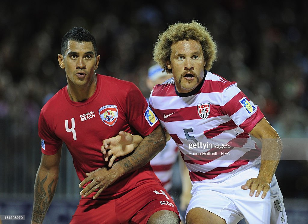Heimanu Taiarui of Tahiti and Lewie Valentine of USA during the FIFA Beach Soccer World Cup Tahiti 2013 Group A match between USA and Tahiti at the Tahua To'ata stadium on September 21, 2013 in Papeete, French Polynesia.