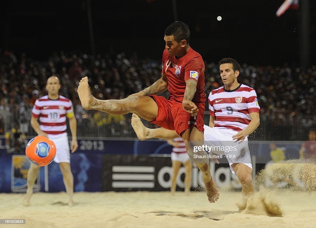 Heimanu Taiarui of Tahiti is challenged by Mario Chimienti of USA during the FIFA Beach Soccer World Cup Tahiti 2013 Group A match between USA and Tahiti at the Tahua To'ata stadium on September 21, 2013 in Papeete, French Polynesia.