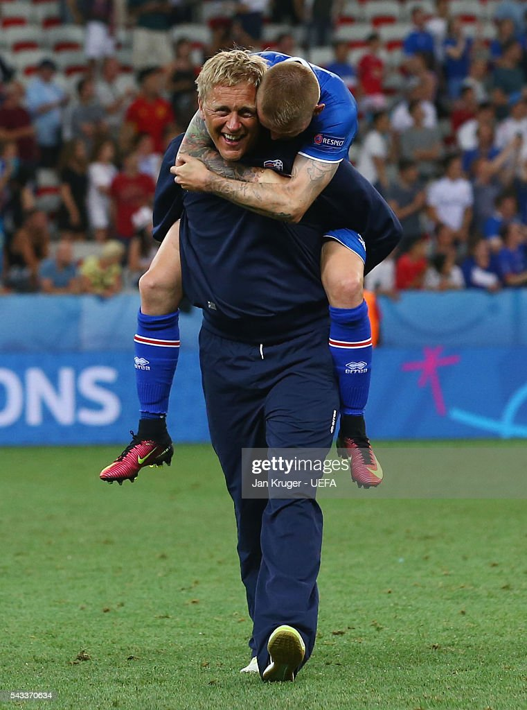 Heimir Hallgrimsson (L) head coach of Iceland and Ari Skulason (R) celebrate their 2-1 win after the UEFA EURO 2016 round of 16 match between England and Iceland at Allianz Riviera Stadium on June 27, 2016 in Nice, France.