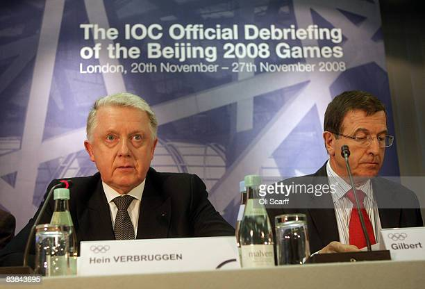 Hein Verbruggen a member of the International Olympic Committee and Gilbert Felli the Olympic Games Executive Director is pictured during closing...