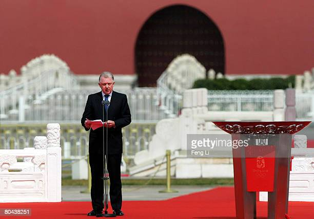 Hein Verbruggen chairman of the International Olympic Committee Coordination Commission for the Beijing 2008 Olympic Games reads a congratulatory...