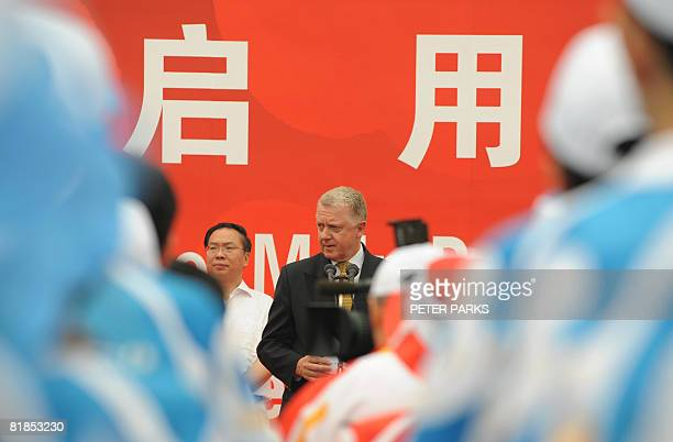 Hein Verbruggen of the International Olympic Committee speaks at a ceremony to open the Olympic Games Media Centre at the Olympic Green in Beijing on...