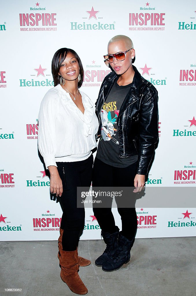 Heineken USA brand manager Carolyn 'CC' Concepcion and model <a gi-track='captionPersonalityLinkClicked' href=/galleries/search?phrase=Amber+Rose+-+Model&family=editorial&specificpeople=2025513 ng-click='$event.stopPropagation()'>Amber Rose</a> attend Heineken Inspire Encore Event featuring Nas, Cee Lo Green, Diplo, Pete Rock, J. Cole and Roxy Cottontail at Basketball City - Pier 36 - South Street on November 13, 2010 in New York City.
