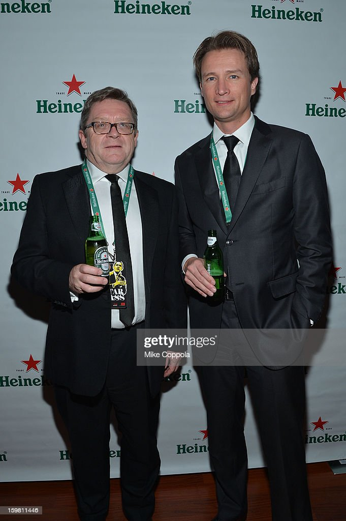 Heineken USA Chief Executive Officer and President Dolf van den Brink poses with a guest at The Hip Hop Inaugural Ball II sponsored by Heineken USA at Harman Center for the Arts on January 20, 2013 in Washington, DC.