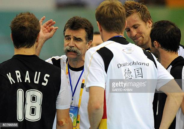 Heiner Brand coach of Germany addresses his players during a 2008 Olympics Games men's handball match against Egypt on August 14 in Beijing Germany...