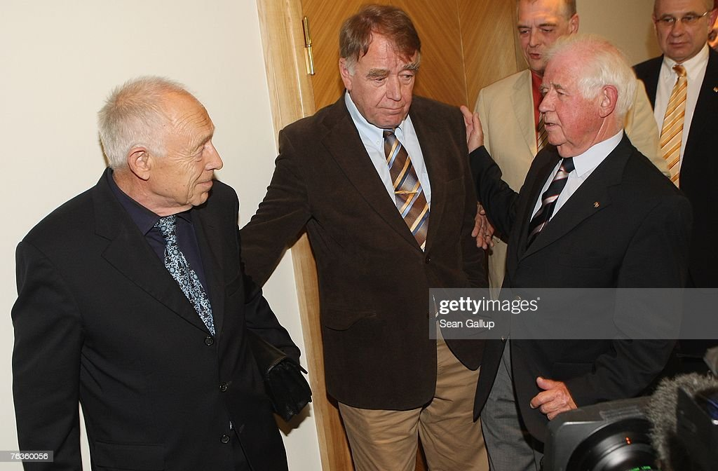 Heiner Geissler (L) and Kurt Biedenkopf (R), mediators in the current negotiations between German rail carrier Deutsche Bahn and the German union of locomotive drivers, the GDL, and GDL head Manfred Schell (C) depart after giving a joint press conference at the Park Inn hotel August 28, 2007 in Berlin, Germany. The two mediators announced they had found enough common ground to reach an agreement in the dispute, which is centered on wages.