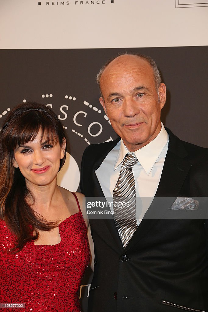 Heiner Lauterbach and Viktoria Lauterbach attend the Natascha & Gernot Gruen 'Golden Red Christmas Night' Party on December 19, 2012 in Munich, Germany.