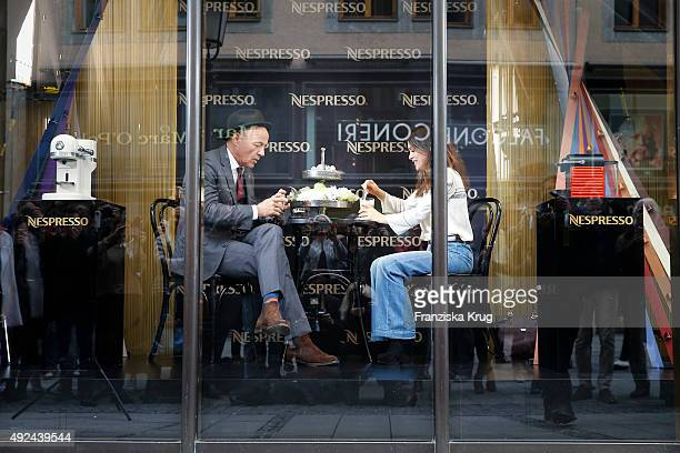 Heiner Lauterbach and Viktoria Lauterbach during the opening of the smallest popup cafe in town by NESPRESSO on October 13 2015 in Munich Germany