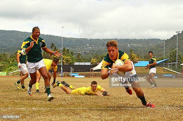 Heino Bezuidenhout of South Africa scores a try during the Rugby Sevens Men's Final match between Australia and South Africa at the Apia Park Sports...