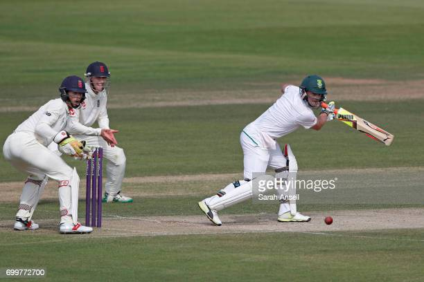 Heino Kuhn of South Africa A hits out as England Lions wicket keeper Ben Foakes and slip fielder Nick Gubbins look on during day 2 of the match...