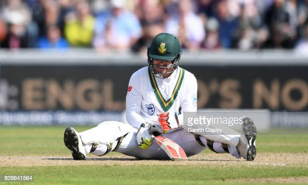 Heino Kuhn of South Africa sits on the ground after mistiming a shot during day two of the 4th Investec Test between England and South Africa at Old...